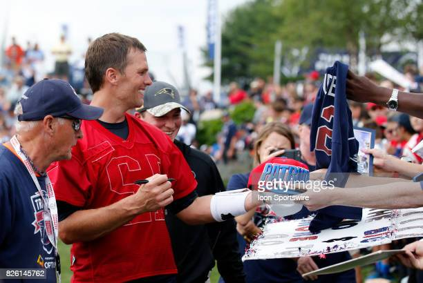 New England Patriots quarterback Tom Brady signs birthday autographs during Patriots training camp on August 3 at Gillette Stadium in Foxborough...