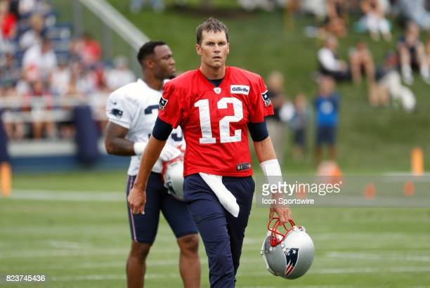 New England Patriots quarterback Tom Brady takes a breather during New England Patriots training camp on July 27 at the Patriots Practice Facility in...