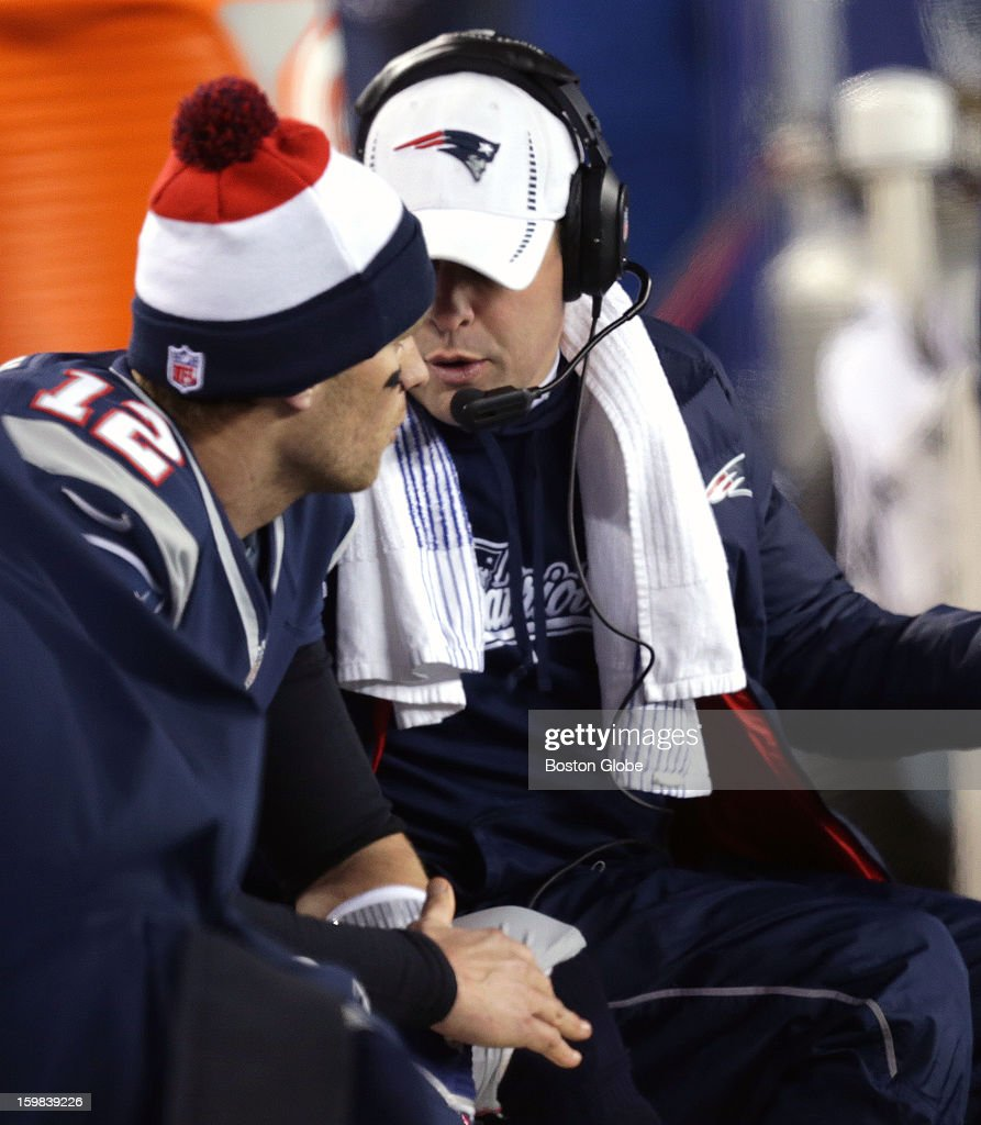 New England Patriots quarterback Tom Brady (#12) talks with Offensive coordinator/quarterbacks coach Josh McDaniels on the bench during the fourth quarter as the New England Patriots hosted the Baltimore Ravens in the AFC Championship Game at Gillette Stadium.