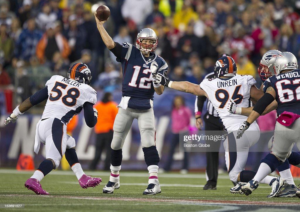 New England Patriots quarterback Tom Brady throws a pass against the Denver Broncos during third quarter action as the New England Patriots hosted the Denver Broncos in an NFL regular season game at Gillette Stadium on Sunday, Oct. 7, 2012.