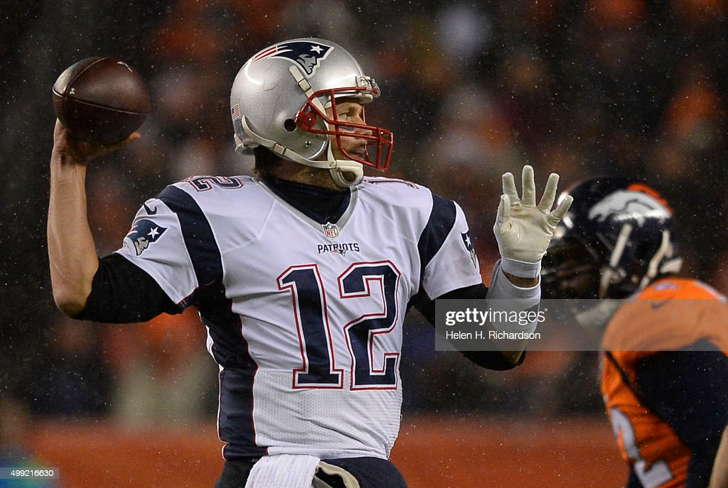 New England Patriots quarterback <a gi-track='captionPersonalityLinkClicked' href=/galleries/search?phrase=Tom+Brady+-+American+Football+Quarterback&family=editorial&specificpeople=201737 ng-click='$event.stopPropagation()'>Tom Brady</a> (12) throws a pass down field against the Denver Broncos during the first quarter November 29, 2015 at Sports Authority Field at Mile High Stadium.