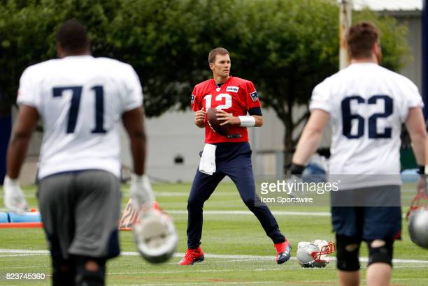 New England Patriots quarterback Tom Brady waits for his teammates to join him on the field during New England Patriots training camp on July 27 at...