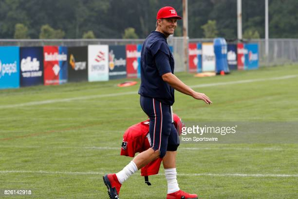 New England Patriots quarterback Tom Brady walks onto the field on his 40th birthday during Patriots training camp on August 3 at Gillette Stadium in...