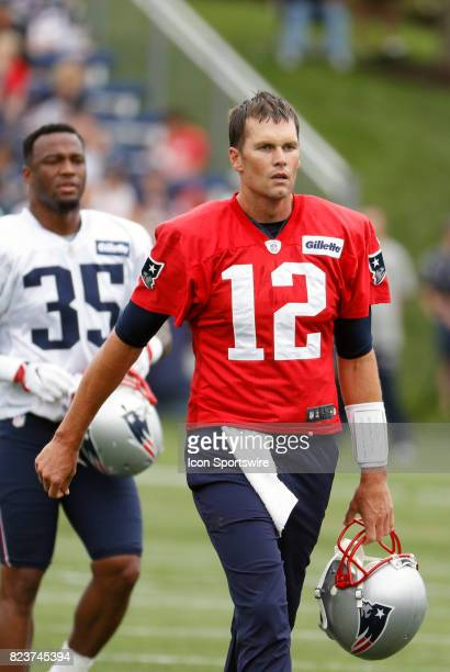 New England Patriots quarterback Tom Brady walks to a drill during New England Patriots training camp on July 27 at the Patriots Practice Facility in...