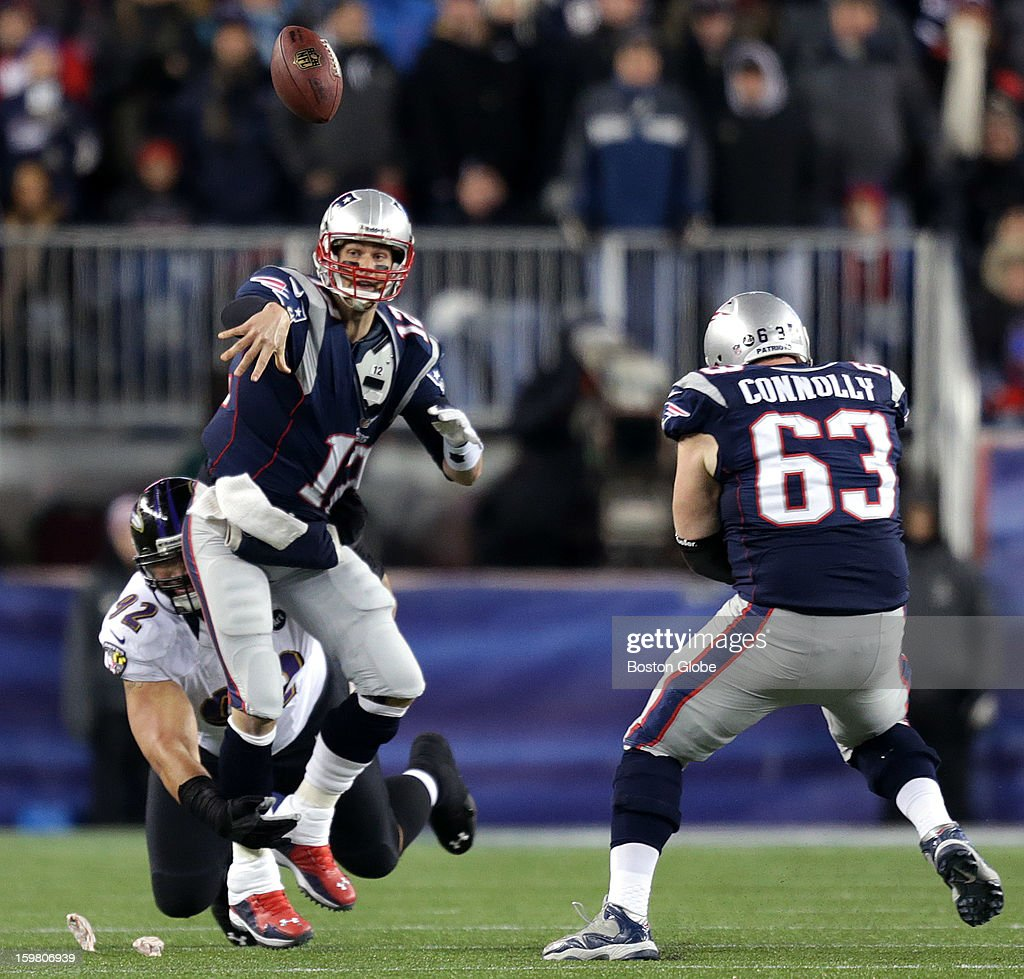 New England Patriots quarterback Tom Brady (#12) was called for intentional grounding on the attempted pass as he was pressured by Baltimore Ravens defensive end Haloti Ngata (#92) in the first quarter as the New England Patriots hosted the Baltimore Ravens in the AFC Championship Game at Gillette Stadium.