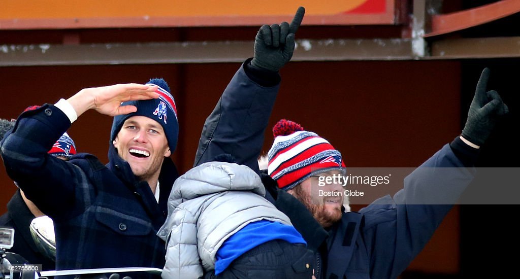 New England Patriots quarterback <a gi-track='captionPersonalityLinkClicked' href=/galleries/search?phrase=Tom+Brady+-+American+Football+Quarterback&family=editorial&specificpeople=201737 ng-click='$event.stopPropagation()'>Tom Brady</a> with his son, Benjamin, salutes during Super Bowl Parade.