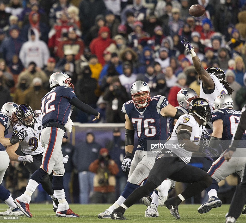 New England Patriots quarterback Tom Brady's pass is tipped at the line of scrimmage, leading to an interception by Baltimore Ravens player Dannell Ellerbe during fourth quarter action of the AFC Championship Game at Gillette Stadium on Sunday, Jan. 20, 2013.