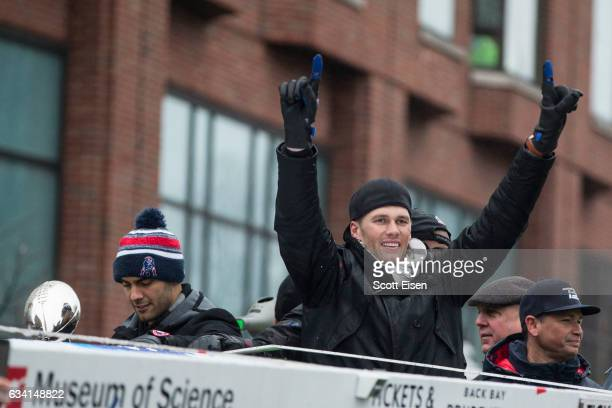 New England Patriots quarterbacks Jimmy Garoppolo and Tom Brady celebrate during the New England Patriots victory parade on February 7 2017 in Boston...