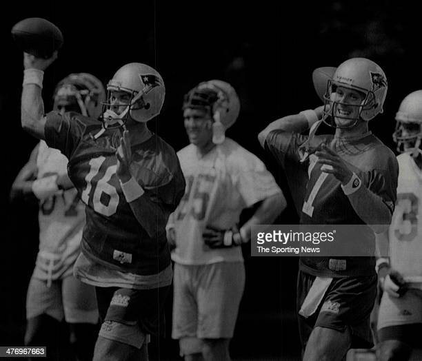 New England Patriots quarterbacks Scott Zolak and Drew Bledsoe throw in tandem during practice August 23 1995 in Wrentham Massachusetts The Patriots...