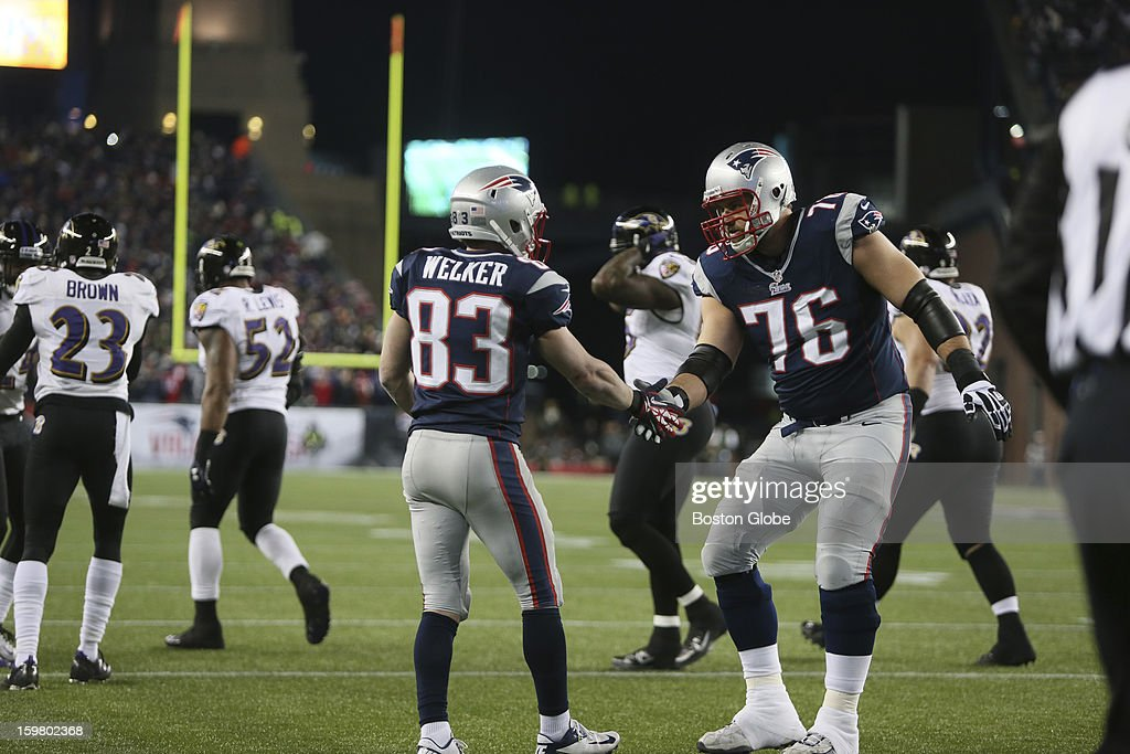 New England Patriots receiver Wes Welker gets a congratulatory handshake from teammate Sebastian Volmer as the New England Patriots hosted the Baltimore Ravens in the AFC Championship Game at Gillette Stadium.