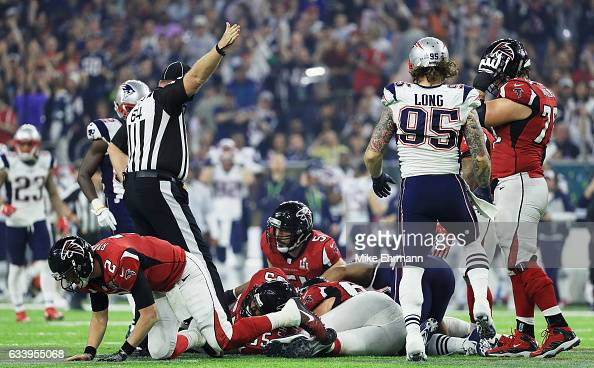 New England Patriots recover a fumble against the Atlanta Falcons in the fourth quarter during Super Bowl 51 at NRG Stadium on February 5 2017 in...
