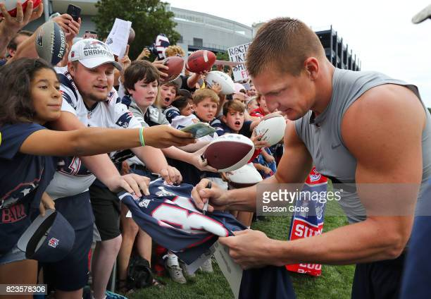 New England Patriots Rob Gronkowski signs autographs after the first day of training camp at the Gillette Stadium practice field in Foxborough Mass...