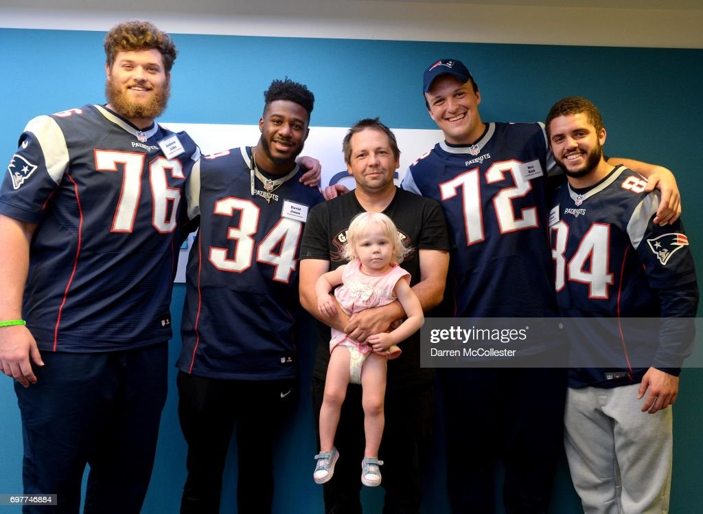New England Patriots rookies (L to R) Andrew Jelks, David Jones, Max Rich, and Austin Carr visit Katie and Dad at Boston Children's Hospital June 19, 2017 in Boston, Massachusetts.