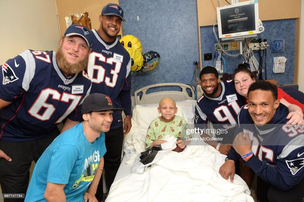 New England Patriots rookies (L to R) Conor McDermott, Antonio Garcia, Deatrich Wise Jr., and Derek Rivers visit Jose and Dad at Boston Children's Hospital June 19, 2017 in Boston, Massachusetts.