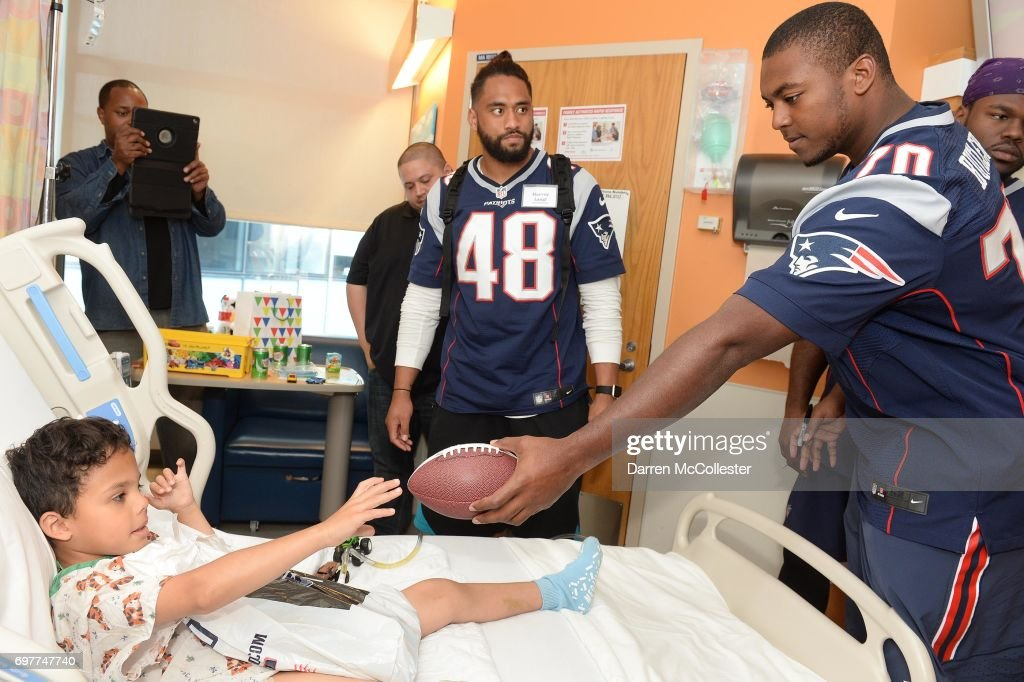 New England Patriots rookies (C) Harvey Langi and Adam Butler (R) visit Jose at Boston Children's Hospital June 19, 2017 in Boston, Massachusetts.