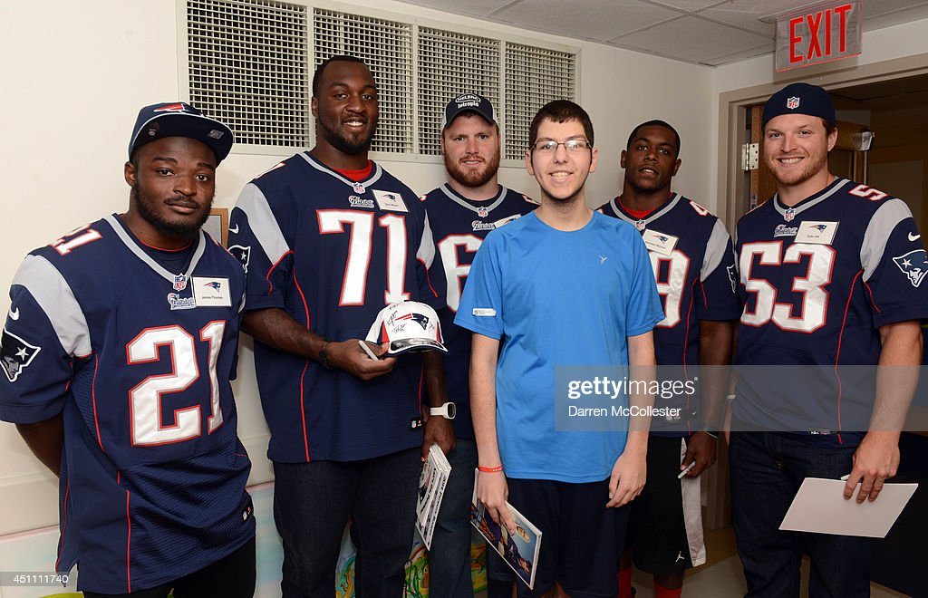 New England Patriots rookies (L to R) Jemea Thomas, Zach Moore, Bryan Stork, Deontae Skinner, and Tyler Ott visit with Joshua at Boston Children's Hospital June 23, 2014 in Boston, Massachusetts.