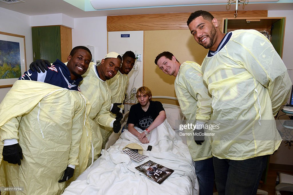 New England Patriots rookies (L to R) Jeremy Johnson, Shamiel Gary, Travis Hawkins, Tyler Ott, Justin Jones, visit with Justin at Boston Children's Hospital June 23, 2014 in Boston, Massachusetts.