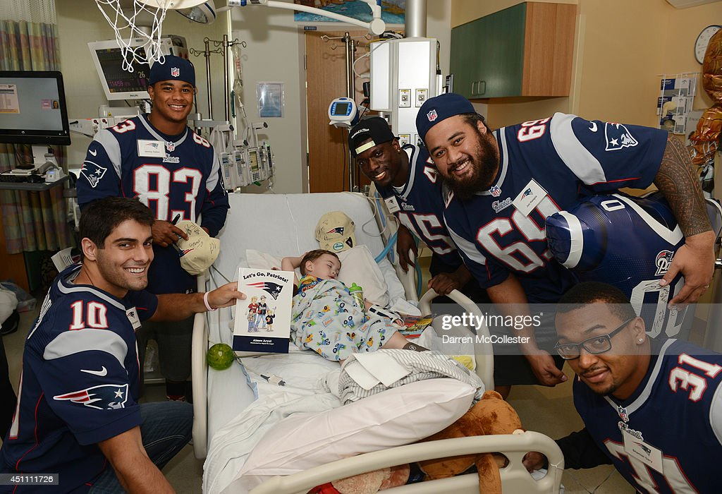 New England Patriots rookies (L to R) Jimmy Garappolo, Jeremy Gallon, Cameron Gordon, John Halapio, Shamiel Gary visit with Shane at Boston Children's Hospital June 23, 2014 in Boston, Massachusetts.