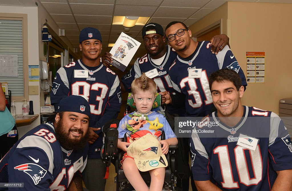 New England Patriots rookies (L to R) <a gi-track='captionPersonalityLinkClicked' href=/galleries/search?phrase=Jon+Halapio&family=editorial&specificpeople=6670964 ng-click='$event.stopPropagation()'>Jon Halapio</a>, <a gi-track='captionPersonalityLinkClicked' href=/galleries/search?phrase=Jeremy+Gallon&family=editorial&specificpeople=7210704 ng-click='$event.stopPropagation()'>Jeremy Gallon</a>, Cameron Gordon, Shamiel Gary, and <a gi-track='captionPersonalityLinkClicked' href=/galleries/search?phrase=Jimmy+Garoppolo&family=editorial&specificpeople=12185713 ng-click='$event.stopPropagation()'>Jimmy Garoppolo</a>, visit with Jordon at Boston Children's Hospital June 23, 2014 in Boston, Massachusetts.