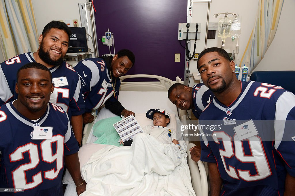 New England Patriots rookies (L to R) Roy Finch, Seal'i Epenesa, <a gi-track='captionPersonalityLinkClicked' href=/galleries/search?phrase=Dominique+Easley&family=editorial&specificpeople=8222854 ng-click='$event.stopPropagation()'>Dominique Easley</a>, Cameron Flemming, and <a gi-track='captionPersonalityLinkClicked' href=/galleries/search?phrase=Malcolm+Butler&family=editorial&specificpeople=12913602 ng-click='$event.stopPropagation()'>Malcolm Butler</a> visit with Liedson at Boston Children's Hospital June 23, 2014 in Boston, Massachusetts.