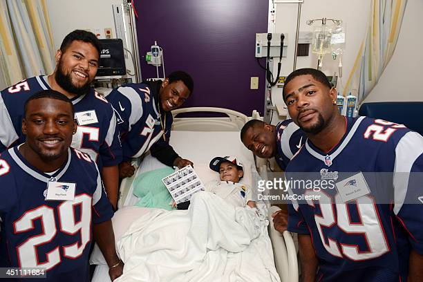 New England Patriots rookies Roy Finch Seal'i Epenesa Dominique Easley Cameron Flemming and Malcolm Butler visit with Liedson at Boston Children's...