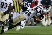 New England Patriots running back Danny Woodhead is hit by New Orleans Saints strong safety Corey White during the second quarter of a preseason...