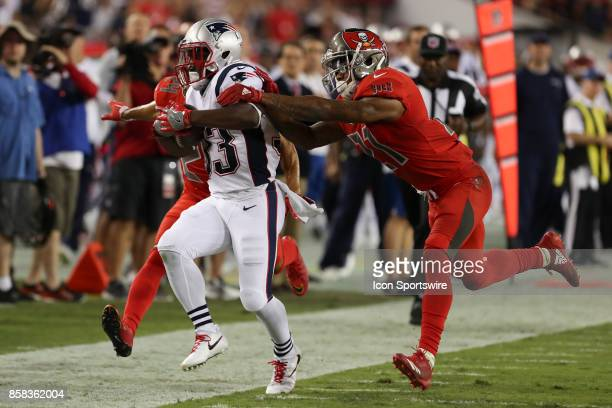 New England Patriots running back Dion Lewis runs for a first down before being forced out of bounds by Tampa Bay Buccaneers safety Justin Evans...