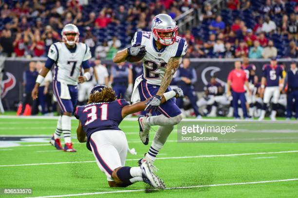 New England Patriots running back DJ Foster breaks a tackle attempt by Houston Texans cornerback Treston Decoud during the NFL preseason game between...
