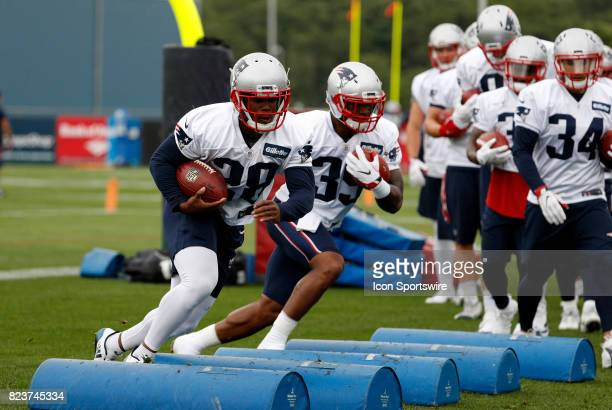 New England Patriots running back James White and New England Patriots running back LeShun Daniels Jr run a drill during New England Patriots...