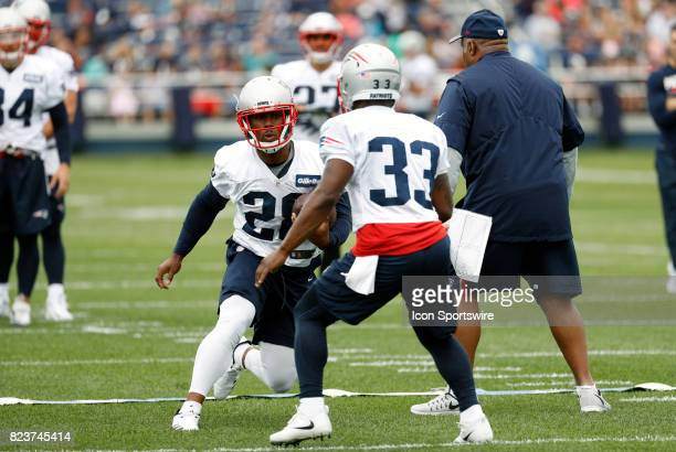 New England Patriots running back James White cuts past New England Patriots running back Dion Lewis during New England Patriots training camp on...