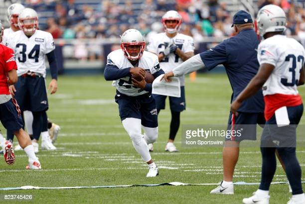 New England Patriots running back James White gets the signal from New England Patriots running backs Coach Ivan Fears during New England Patriots...
