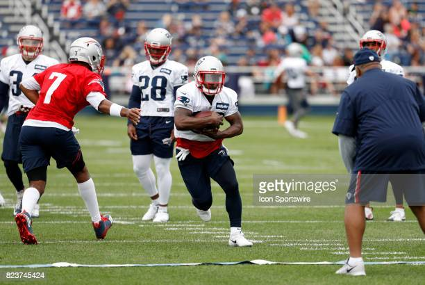 New England Patriots running back James White looks for direction from New England Patriots running backs Coach Ivan Fears after taking the hand off...