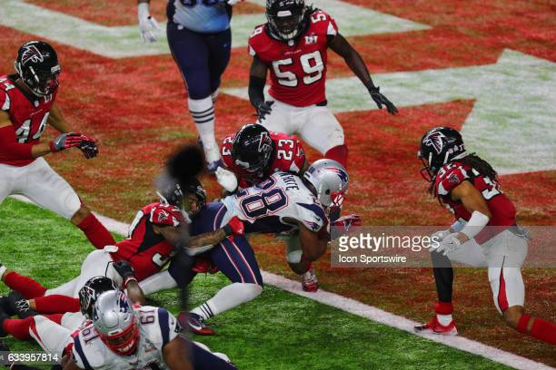 New England Patriots Running Back James White scores the winning touchdown on a 2yard run in overtime during the New England Patriots 3428 victory...