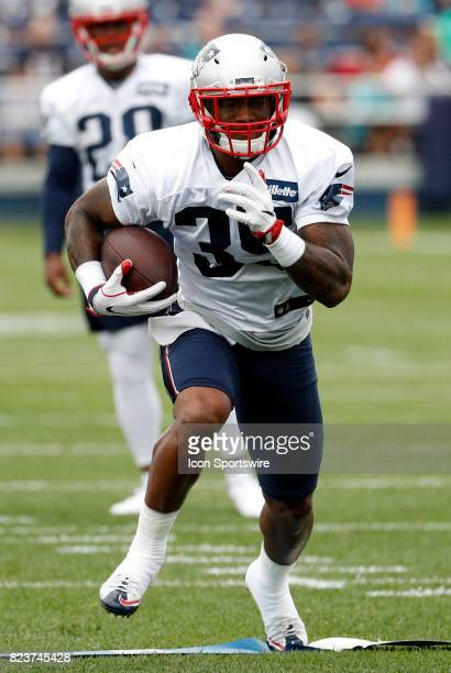 New England Patriots running back Mike Gillislee carries the ball during New England Patriots training camp on July 27 at the Patriots Practice...