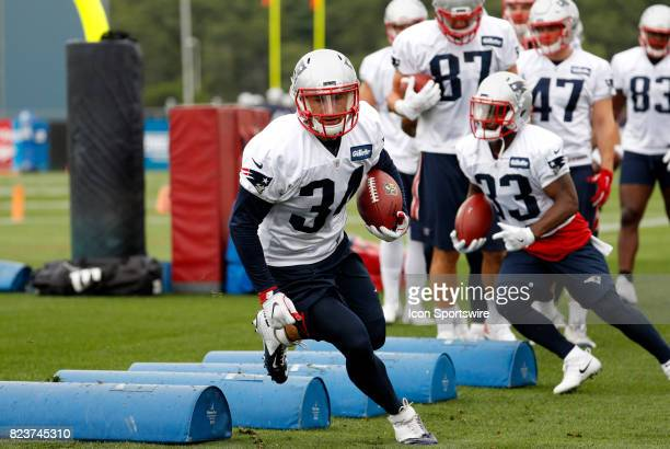 New England Patriots running back Rex Burkhead runs a drill during New England Patriots training camp on July 27 at the Patriots Practice Facility in...