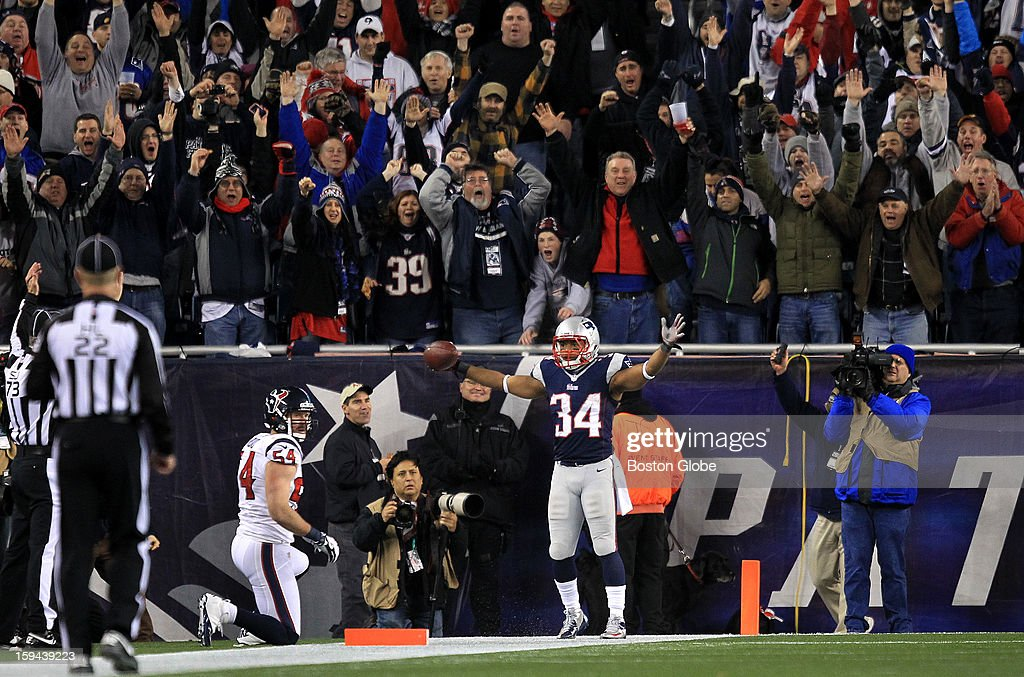 New England Patriots running back Shane Vereen (#34) brought the Patriots fans to their feet after a 33-yard pass reception from New England Patriots quarterback Tom Brady (#12) for Vereen's third touchdown of the game and a 38-13 Patriots lead during the fourth quarter. The New England Patriots hosted the Houston Texans in an NFL AFC Divisional Playoff Game at Gillette Stadium, Jan. 13, 2013.