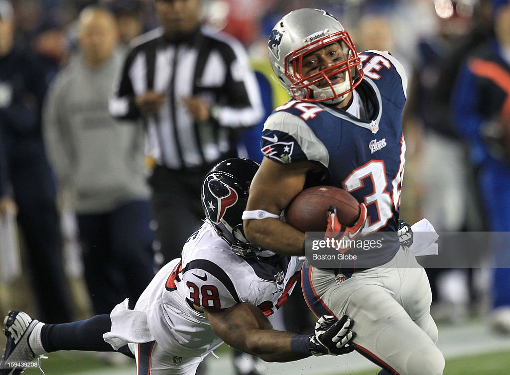 New England Patriots running back Shane Vereen (#34) is brought down by Houston Texans free safety Danieal Manning (#38) but not before picking up a big first down on a pass reception and run during the first quarter as the New England Patriots hosted the Houston Texans in an NFL AFC Divisional Playoff Game at Gillette Stadium, Jan. 13, 2013.