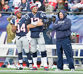 New England Patriots running back Shane Vereen quarterback Tom Brady and coach Bill Belichick watch on the sidelines with the game firmly at hand...