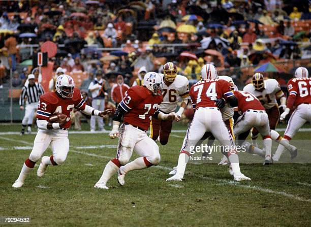New England Patriots running back Vagas Ferguson carries the football behind the blocking of Hall of Fame guard John Hannah during the Patriots 2422...