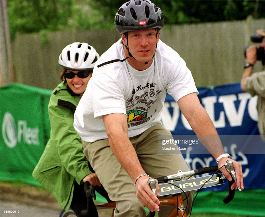 New England Patriots star <a gi-track='captionPersonalityLinkClicked' href=/galleries/search?phrase=Drew+Bledsoe&family=editorial&specificpeople=183356 ng-click='$event.stopPropagation()'>Drew Bledsoe</a> rides a tandem bicycle with Alina Shriver during the Best Buddies Friendship Races in Hyannis Port, Massachusetts on Saturday, May 20, 2000. The races raised money for Best Buddies International.
