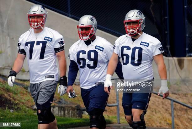 New England Patriots tackle Nate Solder New England Patriots offensive lineman Shaq Mason and New England Patriots center David Andrews walk to...