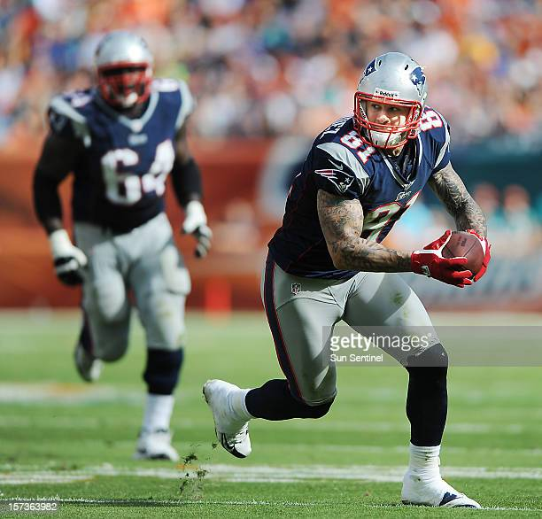 New England Patriots tight end Aaron Hernandez heads up field against the Miami Dolphins at Sun Life Stadium on Sunday December 2 in Miami Gardens...