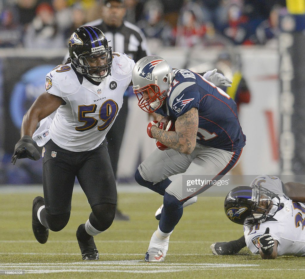 New England Patriots tight end Aaron Hernandez makes a tough catch before getting taken down by Baltimore Ravens inside linebacker Dannell Ellerbe...