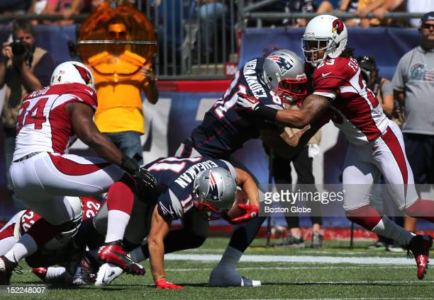 New England Patriots tight end Aaron Hernandez was hurt blocking on this play as he appears to catch his leg or ankle in the turf under a falling New...