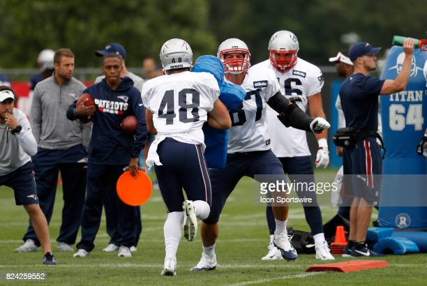 New England Patriots tight end Jacob Hollister tries to block New England Patriots tight end Rob Gronkowski during New England Patriots training camp...