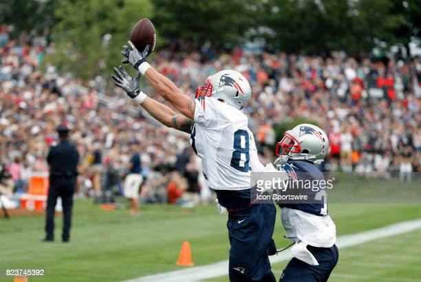 New England Patriots tight end James O'Shaughnessy makes the catch over New England Patriots defensive back Jordan Richards during New England...