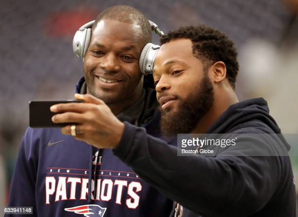 New England Patriots tight end Martellus Bennett poses for a selfie with his brother Michael Bennett who plays for the Seattle Seahawks while on the...
