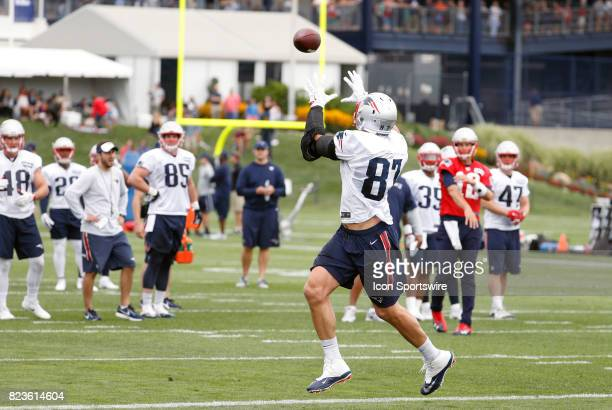 New England Patriots tight end Rob Gronkowski hauls in a pass from New England Patriots quarterback Tom Brady during New England Patriots training...