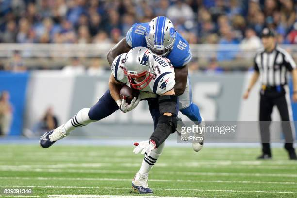 New England Patriots tight end Rob Gronkowski is tackled by Detroit Lions linebacker Jarrad Davis during the first half of an NFL football game in...