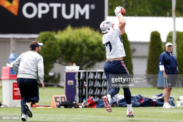 New England Patriots tight end Rob Gronkowski makes a catch under the watchful gaze of New England Patriots tight ends coach Nick Caley during New...